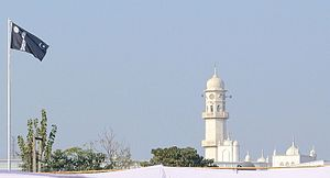 Ahmadiyya - The White Minaret and the Ahmadiyya Flag in Qadian, India. For Ahmadi Muslims, the two symbolise the advent of the Promised Messiah.