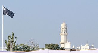 Ahmadiyya - The White Minaret and the Ahmadiyya Flag in Qadian, India. For Ahmadi Muslims, the two symbolize the advent of the Promised Messiah.