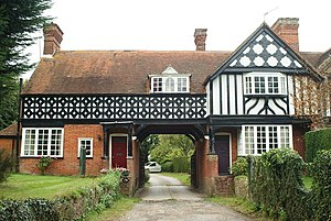 West Clandon - Twin, common mock tudor homes in the village, in this case however, a crossover between a single-family and a semi-detached house