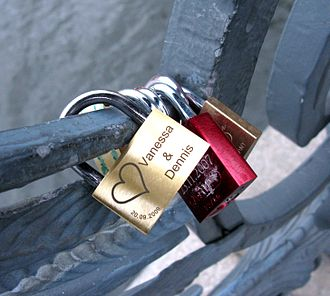 Weidendammer Bridge - Padlocks engraved with the names of lovers, locked onto the wrought-iron railings of the Weidendammer bridge