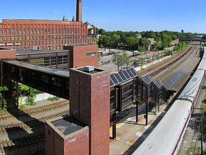 Lowell station with train from garage roof, August 2012.jpg