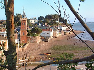 Lympstone river frontage from Cliff Field: Peters Tower and the traditional washing poles on the beach are visible