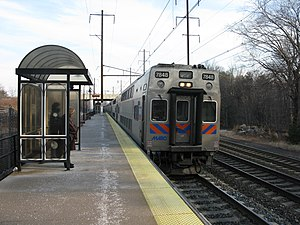 Odenton station - MARC train led by a Kawasaki bi-level cab car enters Odenton station.