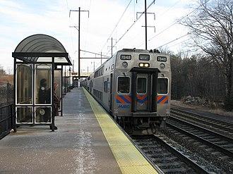 Odenton station - MARC train led by a Kawasaki bi-level cab car enters Odenton station.