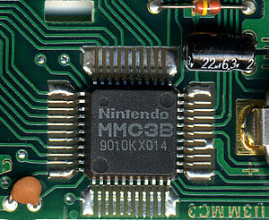 Memory management controller - The MMC3 chip, soldered onto a PCB containing Super Mario Bros. 3 and others.