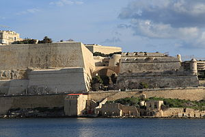Outwork - View of the fortifications of Valletta, with the main fortification (a bastion) to the left, the ditch in the centre, and the outwork (a counterguard) to the right.