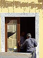 Man in Doorway - Shkodra - Albania (40780293640).jpg