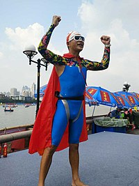 Man wearing body-skin swimsuit near the Pearl River.jpg