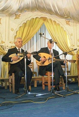 Algerian mandole - Mandola (left) and an Algerian mandole. The mandole has characteristic diamond sound hole.