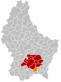 Map of Luxembourg with Weiler-la-Tour highlighted in orange, the district in dark grey, and the canton in dark red