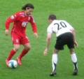 Mauro Zárate and Brian McBride.png