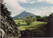 Mayon Volcano in the Philippines overlooks a pastoral scene.