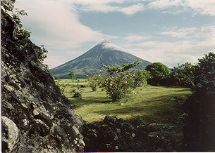 Mayon Volcano overlooks a pastoral scene approximately five months before the volcano's violent eruption in September 1984.