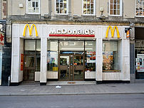 A McDonald's restaurant in Exeter, Devon. This and other McDonald's restaurants around the world have since been redesigned, and a newer image of the same restaurant can be seen at :Image:McDonald's in Exeter 2007.jpg.