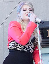Meghan Trainor performing on stage