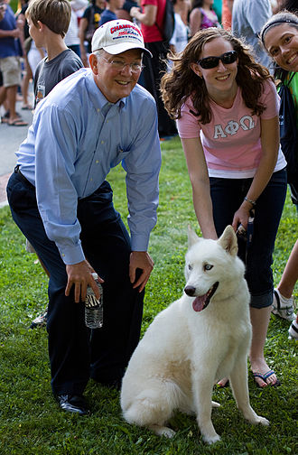 Jonathan the Husky - The canine Jonathan XIII with former president of UConn, Michael Hogan.