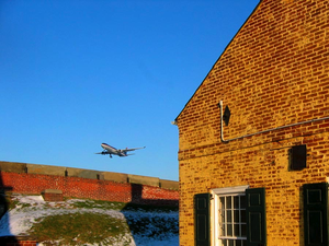 Southwest Philadelphia - US Airways Airbus A330 landing at PHL, as seen from Fort Mifflin