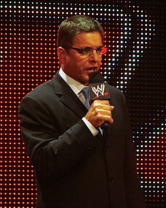 Mike Adamle - Mike Adamle as the General Manager of WWE's Raw brand