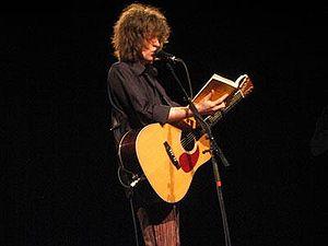 Mike Scott (musician) - Mike Scott reads aloud at a concert in Antwerp in 2004.