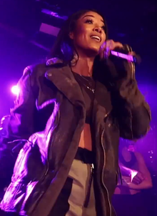 Mila J performing in 2018