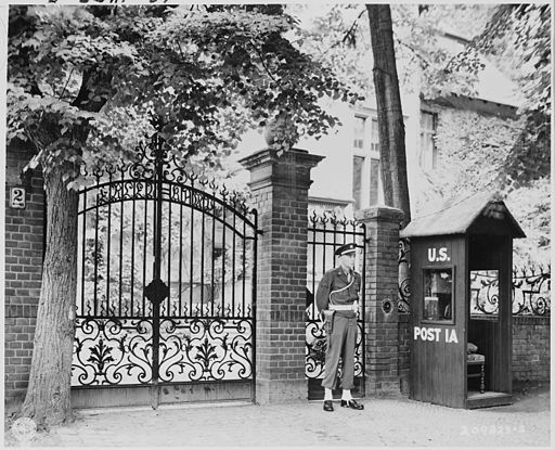 """Military Police stand guard at entrance to the """"Little White House,"""" residence of President Truman in Babelsberg... - NARA - 198937"""