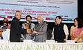 Mohd. Hamid Ansari being presented a memento, at the International Relations Conference 2015 'Link West India and Gulf', at the Symbiosis International University, in Pune, Maharashtra. The Governor of Maharashtra.jpg