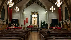 Moravian star - A Moravian Star hangs above a Nativity scene in the sanctuary of St. Paul Roman Catholic Church (on left).