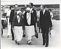 Mother Teresa walking with Br. Francis Blouin .jpg