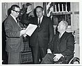 Mr. James A. Broyer being sworn in as a member of the Zoning Board of Adjustment by City Clerk Joseph M. Dunles as Mayor John F. Collins observes (12931814074).jpg