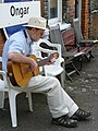 Musician Entertaining at Ongar Station - geograph.org.uk - 1164738.jpg