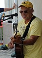 Musician Jimmy Buffet performs for members of Joint Task Force Haiti behind the U.S. Embassy in Port-au-Prince, Haiti, March 3, 2010 100303-N-HX866-001.jpg