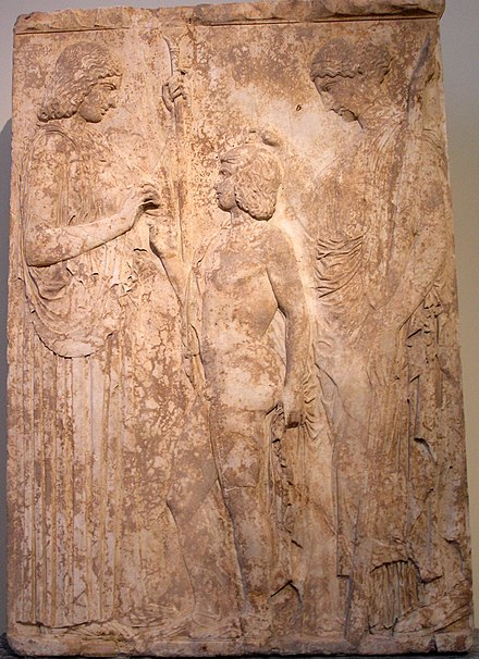 Triptolemus standing between Demeter and Kore, relief from the National Archaeological Museum of Athens NAMA Triade eleusinienne.jpg