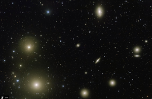Section of the Fornax galaxy cluster around NGC 1382 (in the center of the image, small), recorded with the help of the VST.  The surrounding galaxies are (clockwise) NGC 1380, NGC 1374, and NGC 1375, indented NGC 1381, NGC 1379, NGC 1387, NGC 1399, followed by two emerging stars.