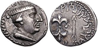"Ariaca - Coin of Nahapana (119-124 CE). Obv: Bust of king Nahapana with a legend in Greek script ""PANNIΩ IAHAPATAC NAHAΠANAC"", transliteration of the Prakrit Raño Kshaharatasa Nahapanasa: ""King Kshaharata Nahapana"". Rev: Thunderbolt and arrow, within a Prakrit Brahmi legend to right: Rajno Ksaharatasa Nahapanasa: Prakrit Kharoshti legend to left: Rano Ksaharatasa Nahapanasa."