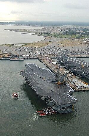 Economy of Norfolk, Virginia - USS John F. Kennedy (CV-67) arriving at Naval Station Norfolk