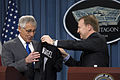 New Zealand Minister of Defense Jonathan Coleman, right, presents Secretary of Defense Chuck Hagel with a jersey from New Zealand's national rugby team, the All Blacks during a joint press conference in t 131028-D-BW835-325.jpg