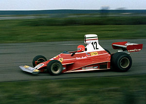 Silverstone Circuit -  Niki Lauda taking the Ferrari 312T through Maggotts Copse during 1975 John Player Grand Prix, Silverstone