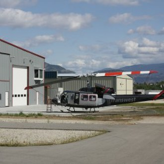Oliver, British Columbia - A helicopter lands at Transwest