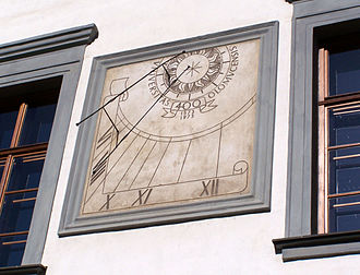 Palacký University - A sundial commemorating the quatercentenary of Olomouc University (1573–1973) on the facade of the Faculty of Philosophy
