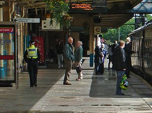 Newport railway station -  A Class 158 Express Sprinter units, at Newport Station on 13 August 2008. A Police Community Support Officer (PCSO) of the British Transport Police can be seen on duty walking on the platform