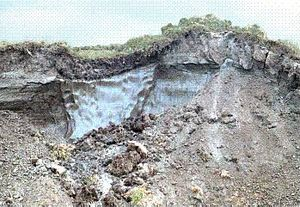 Permafrost - Slope failure of permafrost soil, revealing ice lenses.