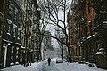 Person walks west village street (Unsplash).jpg