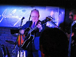 Peter Asher playing in Boston 2012.jpg