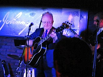 Peter Asher - Asher performing at Johnny D's in Somerville, Massachusetts, on 8 August 2012