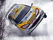 A Peugeot 206 WRC being driven by Juuso Pykälistö in the 2003 Swedish Rally.
