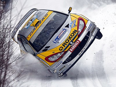 Juuso Pykälistö of Finland in his Peugeot 206 WRC during the 2003 Swedish Rally, part of the World Rally Championship