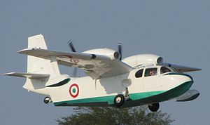 Amphibious aircraft - Italian Air Force Piaggio P.136 during takeoff retracting the wheels that make it an amphibian.