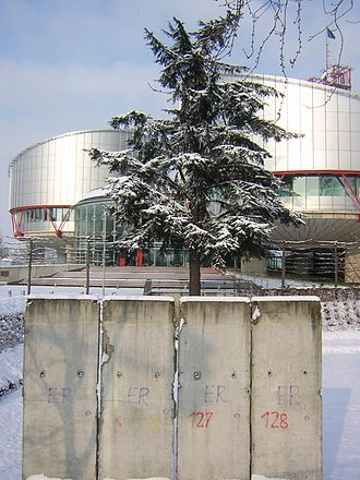 European Court of Human Rights - A piece of the Berlin Wall in front of the European Court of Human Rights.