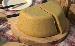 Polenta - Polenta served in the traditional manner on a round wooden cutting board