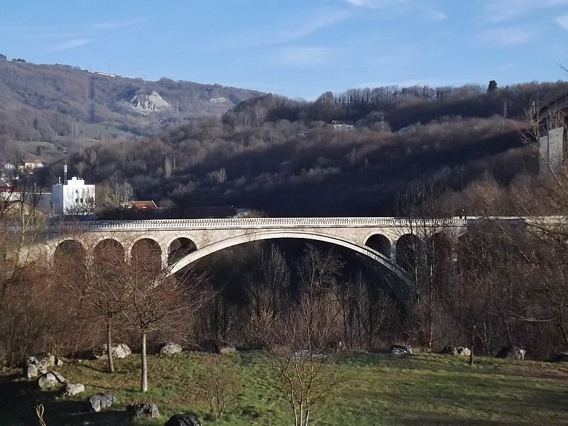 Sight of the pont de Savoie bridge, crossing the Rhône river at the entrance of Bellegarde-sur-Valserine in Ain (left) coming from Haute-Savoie, in France.
